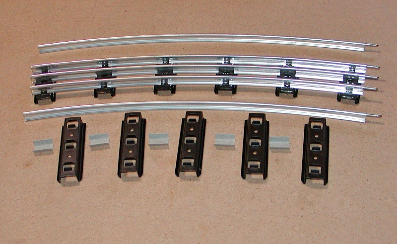 tinplate times the components for a curved section include the lionel 0 gauge section five standard gauge ties to fit between the six 0 gauge ties along their